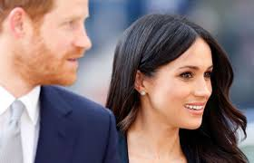 queen elizabeth ii beams after winning a a 98 voucher from meghan markle wears stella mccartney cape dress fit for queen
