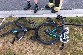 car allegedly doing u turn hits group of river loop cyclists in
