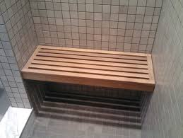 bathroom design custom teak shower bench on beige tile floor