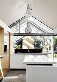 natural indoor garden with skylights designed beside open kitchen
