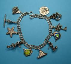 vintage sterling silver hawaiian theme charm bracelet from