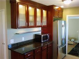 Cherry Cabinets And Backlit Frosted Glass Doors Reinke - Glass kitchen doors cabinets