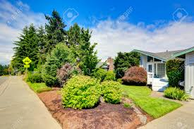 Curbside Appeal House Exterior With Curb Appeal View Of Front Yard Landscape