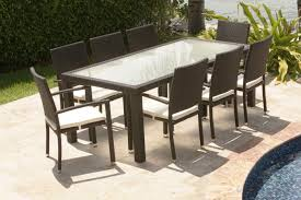 stylish outdoor patio with rattan dining chairs and table with