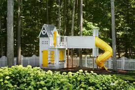 decorating yellow accents on playhouse in kids play area with
