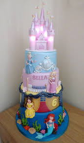 best 25 disney princess castle ideas on pinterest disney 4 tier disney princesses birthday cake with an illuminated castle