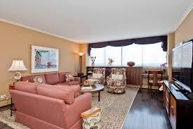 sofa and loveseat living room transitional with medium hardwood