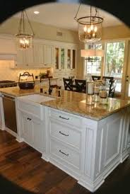 antique white cabinets brown granite hardwood floors kitchen