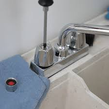 removing the set that holds the faucet handle in place remove
