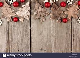 rustic christmas top border with wood ornaments and red baubles on