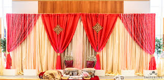 wedding anniversary backdrop bold colors fresh flowers and much more imperial decor