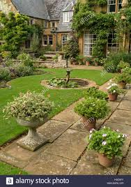 patio pots and planters in gardens of coton manor house coton