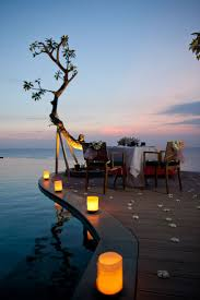 romantic candle lit honeymoon dinner spot for two at anantara bali