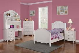 white kids bedroom furniture blue bedding beside wooden table