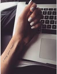minimalist wrist font tats
