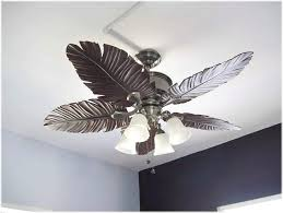 bathroom ceiling fan with decor that has a white ceiling with a
