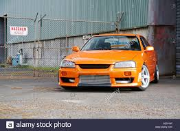 nissan skyline r34 quarter mile modified japanese r33 nissan skyline car performing a tyre warming