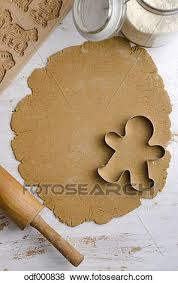pictures of gingerbread dough with gingerbread man cookie cutter