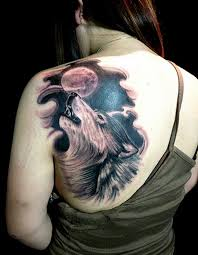 black wolf and moon on shoulder tattoomagz
