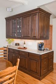 medium brown oak kitchen cabinets dining room buffet in a medium brown stain cabinets