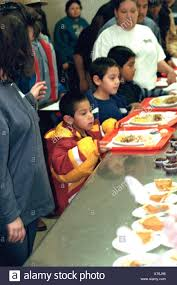 boys age 5 and 7 in line for soup kitchen thanksgiving dinner