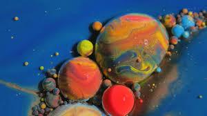 vibrant wallpaper bubble bursting dissolving in water 4k moving liquid color texture