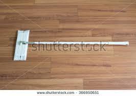 paper mop wood floor background stock photo 241025743
