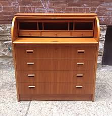 another teak roll top desk this might be the exact one things