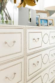 lively coastal beach house hgtv dream home elegant nail head bowen chest ethan allen adds character and texture the kitchen rather