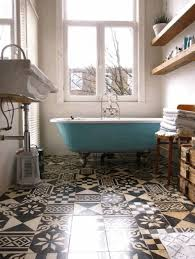 colorful bathroom tile bronze colored jar with plant white