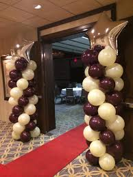 red carpet and balloon columns with star for corporate breakfast