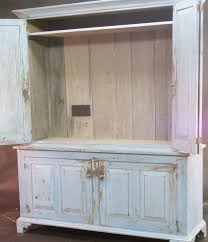 Glass Tv Cabinets With Doors by Rustic Stained Mahogany Wood Tv Cabinet With Swing Doors Of