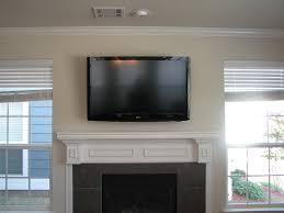 tvs mounted above fireplace tv over valiet org wall mount loversiq
