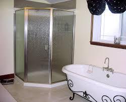 classic bathroom with neo angle corner shower stalls and rain
