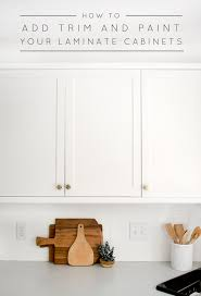 kitchen cabinets top trim how to add trim and paint your laminate cabinets brepurposed