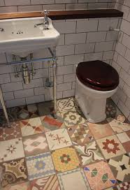 cheap bathroom flooring ideas small bathroom flooring ideas with mixed antique tiles hupehome