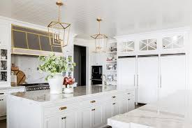 mirrored kitchen cabinets over side by side refrigerators