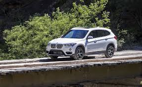 bmw x1 vs audi q3 2018 bmw x1 in depth model review car and driver