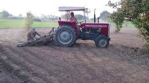 tractor ploughing the field massey ferguson 240 tractor youtube