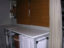 Storage Ideas For Laundry Rooms by Incredible Laundry Room With White Laundry Folding Table And