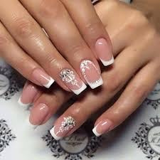 elegant french tip nails with rhinestones and scroll work nails