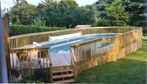 landscaping on a budget a big blue above ground pool in landscaped