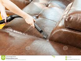 What To Clean Leather Sofa With Cleaning Sofa With Vacuum Cleaner Stock Image Image Of