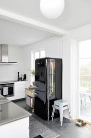 dark wood floors with off white cabinets black appliance wood floors