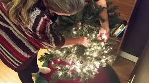 putting lights on the christmas tree youtube