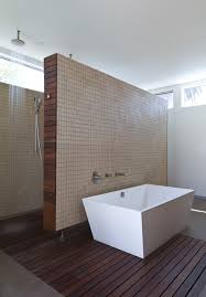 Using Laminate Flooring For Walls White Boxes Bathtub On Brown Wooden Laminate Flooring Design Idea
