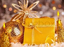 golden gift box with baubles decorations and candles