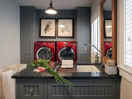 small laundry room after makeover with red front loading washer
