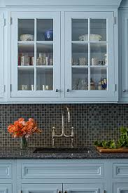 custom blue painted kitchen cabinetry featuring rutt handcrafted
