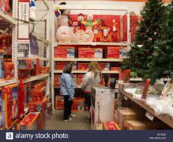 shoppers looking for christmas decorations at a home depot store